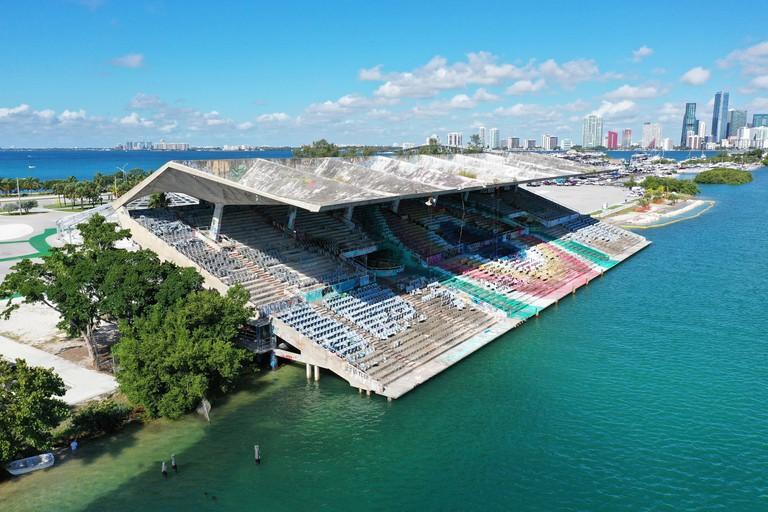Miami, Florida 9-28-19: Miami Marine Stadium designed by Hilario Candela on Virginia Key with Miami skyline and Rickenbacker Causeway in background.