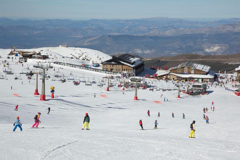 Skiers in the Borreguiles area of the Sierra Nevada ski slopes, Granada, Andalusia, Spain