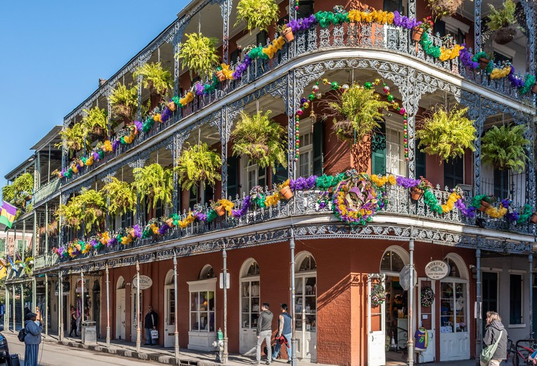 New Orleans French Quarter balcony during Mardi Gras 2020 season, LaBranche House at corner of Royal Street and St. Peter, New Orleans, Louisiana.