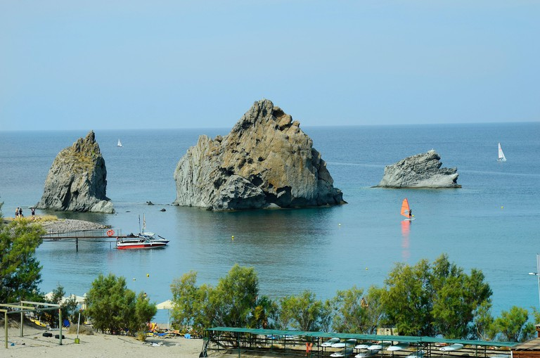 Greece, beach and black rocks on Lemnos island