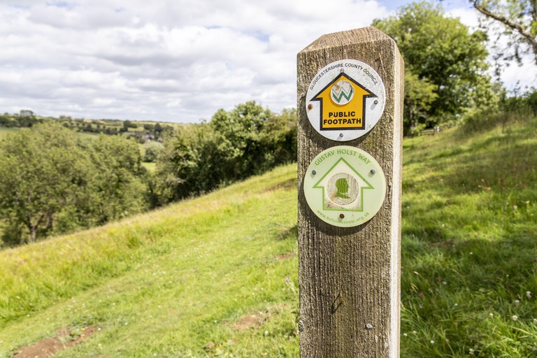 A public footpath (the Gustav Holst Way, the Wardens Way and the Diamond Way) in the valley of the River Windrush near the Cotswold village of Naunton