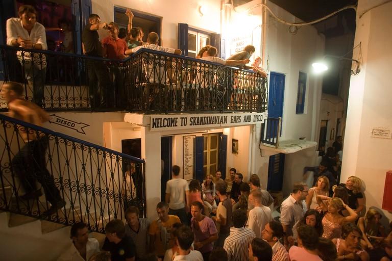 People going clubbing in the Scandinavian Bar and Disco Mykonos Town Mykonos Greece