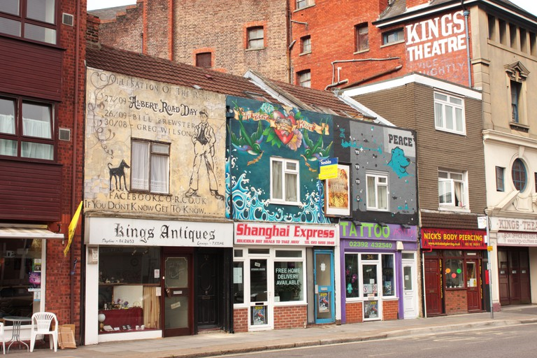 Murals painted above shops in Albert Road Portsmouth UK