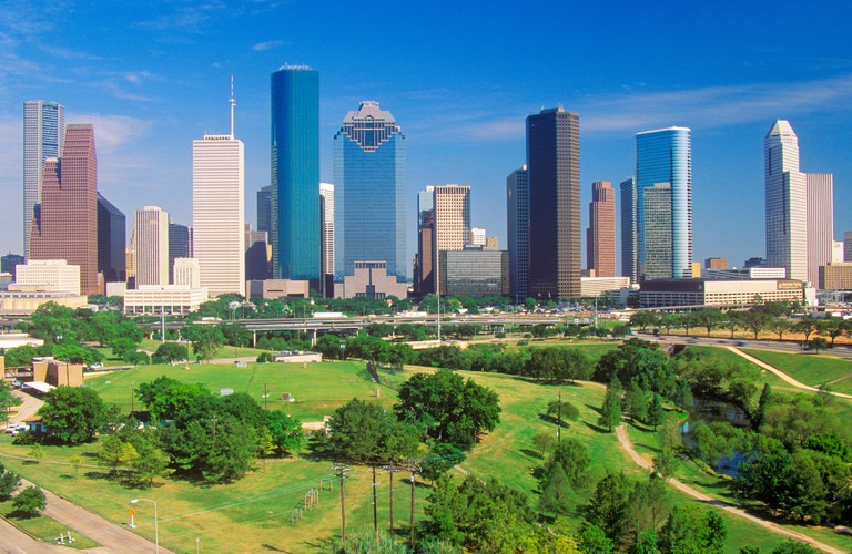 Houston TX skyline in the afternoon with Memorial Park in foreground
