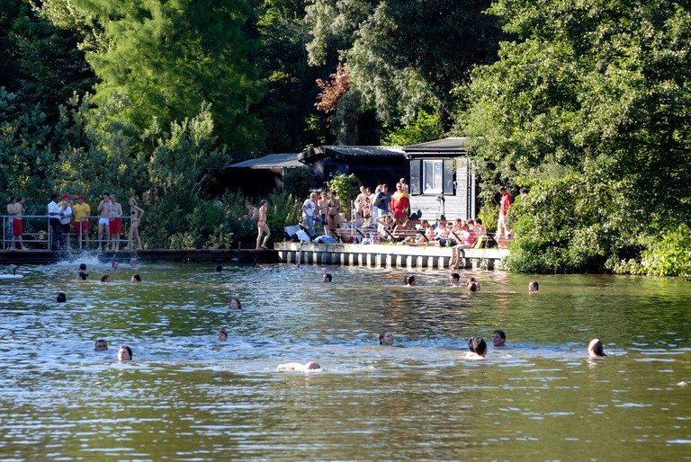 Swimmers at the Mixed Bathing Pond on Hampstead Heath London