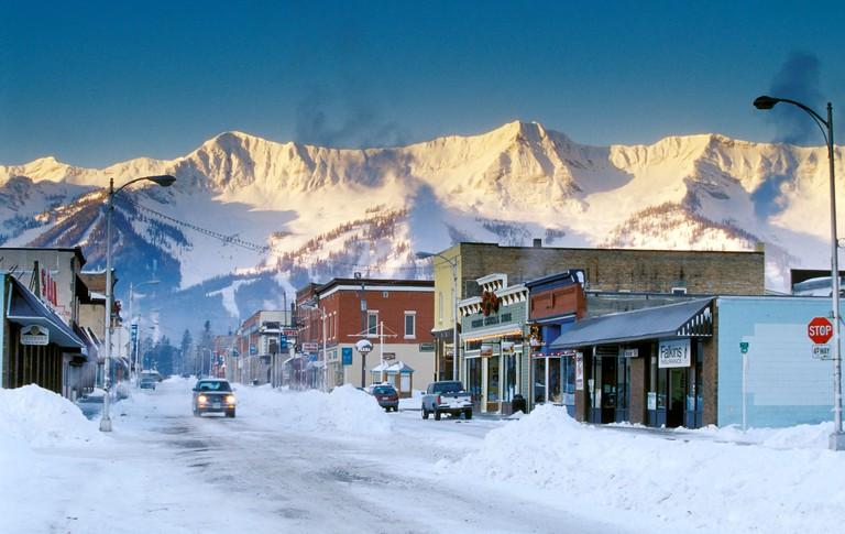 View of Second Avenue (Victoria Avenue) Fernie Alpine Resort and Lizard Range in background, Fernie, British Columbia, Canada.