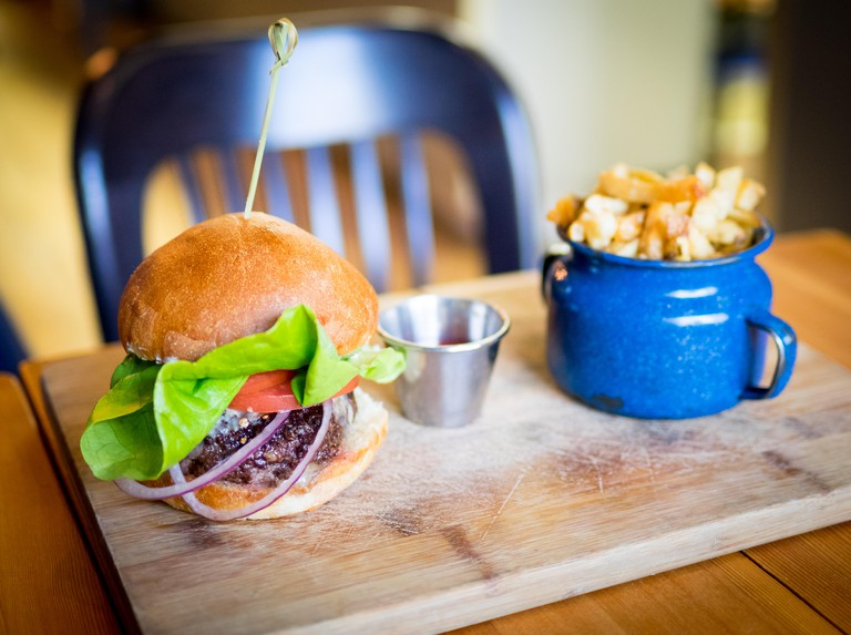 A classic burger and fries (hamburger and French fries) from Ayden Kitchen and Bar in Saskatoon, Saskatchewan, Canada.