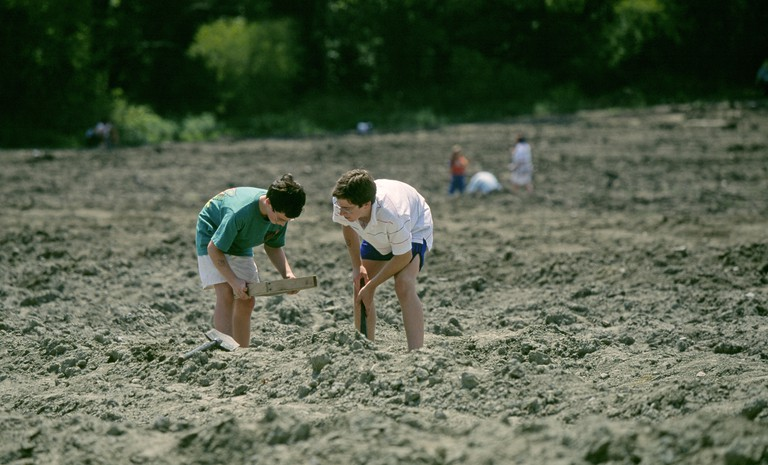 Murfreesboro Visitors digging for diamonds at Crater of Diamonds State Park in southern Arkansas