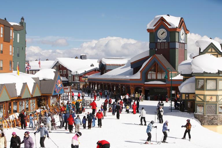 Village with skiers at Big White Ski Resort, Kelowna, British Columbia, Canada.