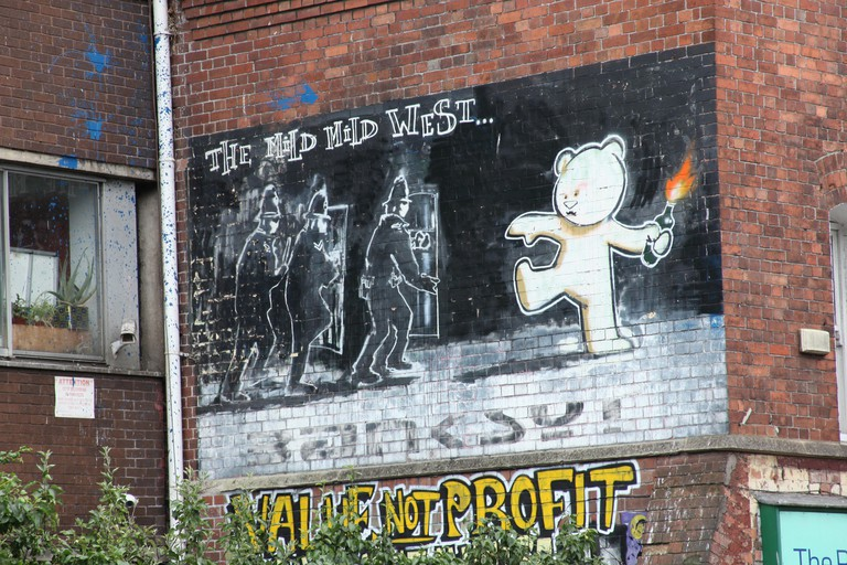 Street art from Banksy, The Mild Mild West in Stokes Croft, Bristol, England.