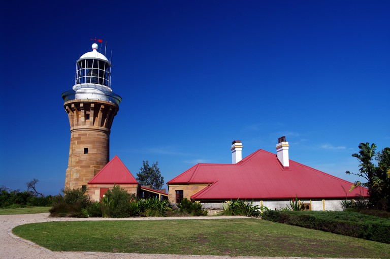 The historic Barrenjoey Head Lighthouse marks the entrance to Broken Bay and Pittwater on the Hawkesbury River. NSW, Australia.