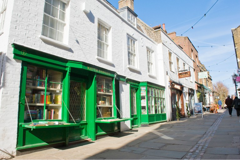Hampstead , London , Flask Walk , pedestrian mews with Keith Fawkes collectible old & antique book shop in foreground