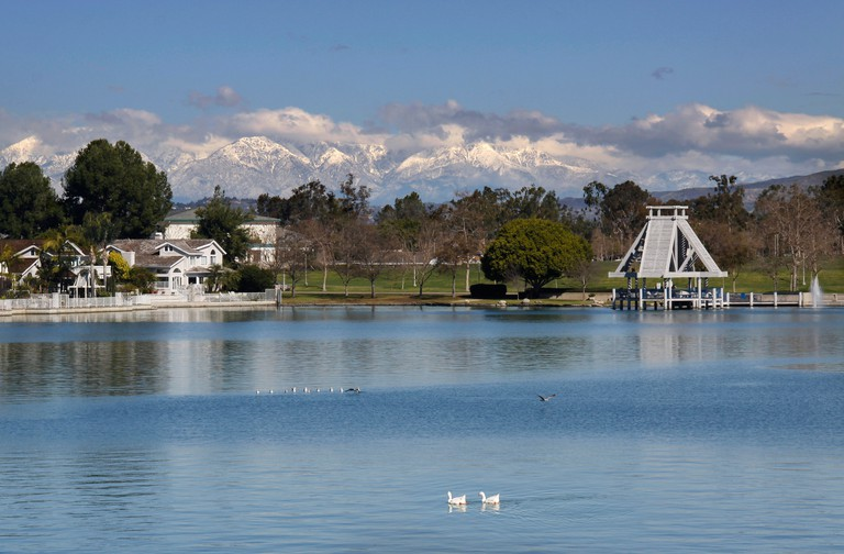 Irvine Woodbridge south lake,with snow capped mountains view.