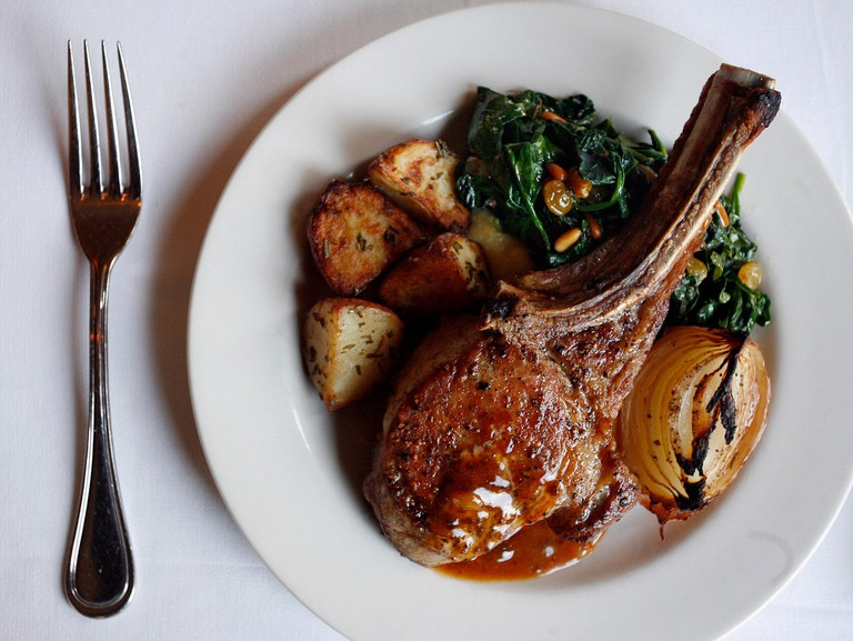 SP_302543__KEEL_BIRMINGHAM_10 (03/11/2009 BIRMINGHAM, ALABAMA) 10. A pork chop entree is offered by Birmingham, Alabama chef and restaurateur Frank Stitt at his Bottega Restaurant and Cafe. Stitt recently published a cookbook called Bottega Favorita: Fran