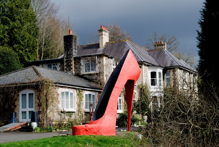Broomhill  Art Hotel and sculpture park with its sculpture of a giant red stiletto shoe, Muddiford, Barnstaple, Devon, UK