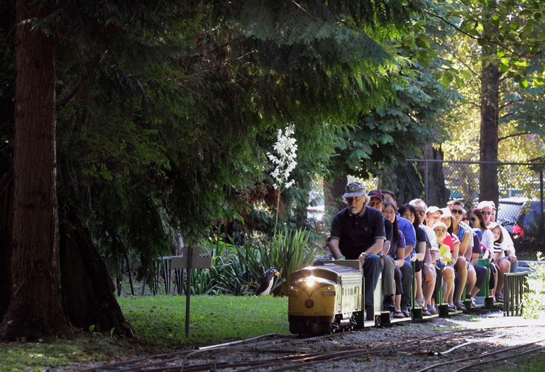 Burnaby, Canada. 2nd Aug, 2014. People take a ride on a miniature train at Burnaby Central Railway in Burnaby, Canada, Aug. 2, 2014. To celebrate the British Columbia Society of Model Engineers' 85th anniversary, local miniature train enthusiasts held an