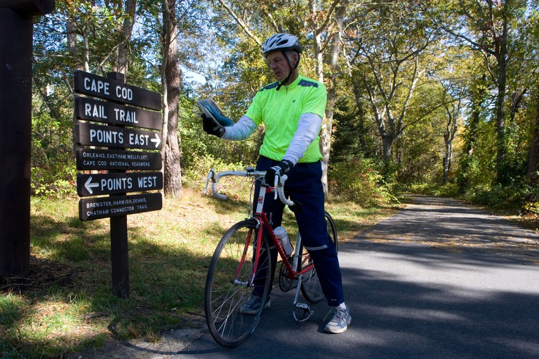 Cape Cod: Nickerson State Park / Cape Cod Trail with sign & cyclist