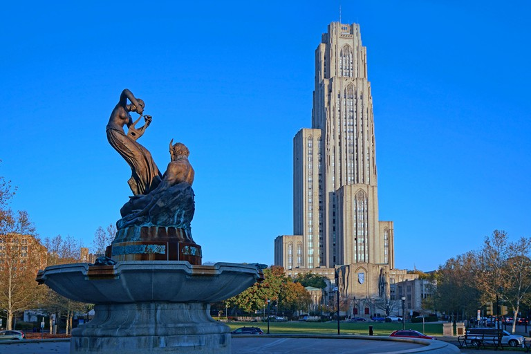 PITTSBURGH - NOVEMBER 2019:  University of Pittsburgh's Cathedral of Learning skyscraper and  Schenley Park Memorial Fountain dating from 1889.