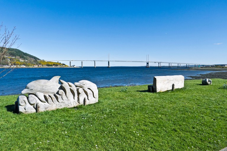 Kessock Bridge linking Inverness with The Black Isle in Scotland seen from the Merkinch Local Nature Reserve with sculptures