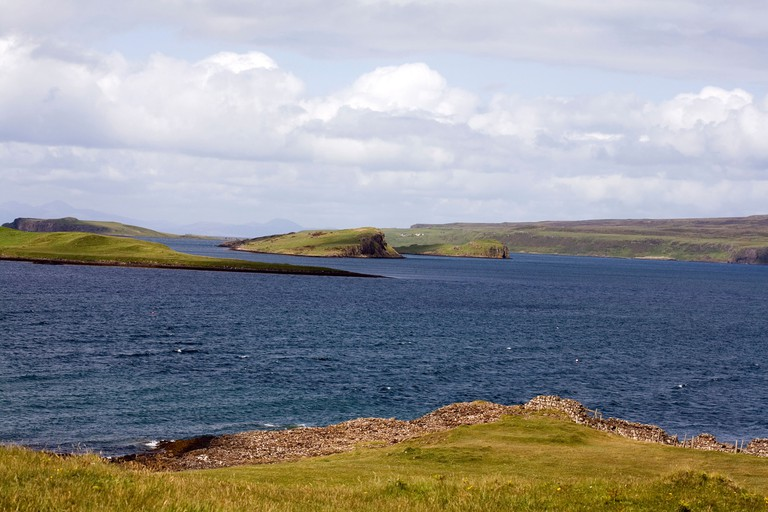 The small islands of Iosaigh Mingay and Clett  of the shoreline at Claigan Dunvegan Isle of Skye Scotland