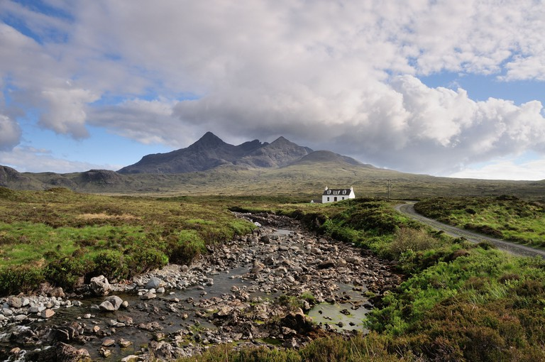 Alltdearg House and the jagged peaks of the Black Cuillin mountains, Isle of Skye, Scotland