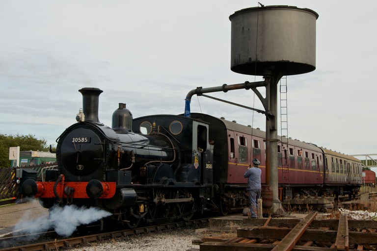 Steam Locomotive at Buckinghamshire Railway Centre, Quainton, taking on water before giving visitors a trip.