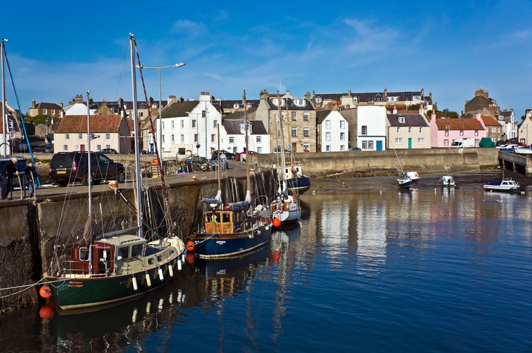 Boats moored in St Monans harbour in the Neuk of Fife Scotland
