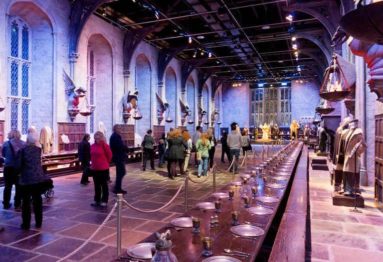 visitors in The Great Hall at the Harry Potter World Warner Bros Studio Tour Leavesden Watford London UK GB EU Europe