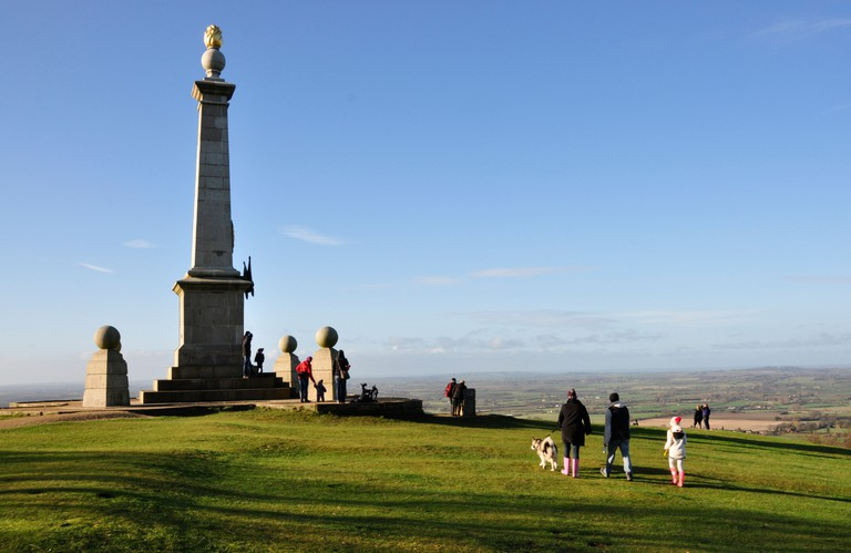 Bucks Chiltern Hills at the monument on Coombe Hill - winter sunlight - blue sky - walkers - dogs - families - enjoying view