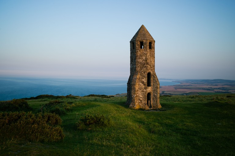 St. Catherine's Oratory, Isle of Wight at dawn. Known locally as the pepperpot, the oratory is a medieval lighthouse.