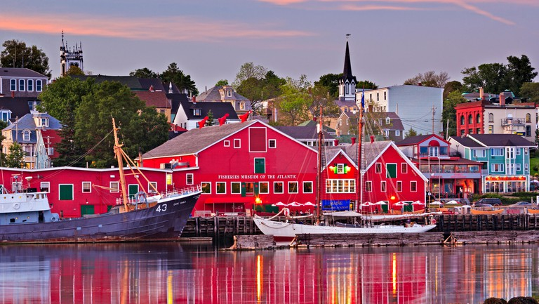 Fisheries Museum of the Atlantic and town of Lunenburg at sunset, Lunenburg Harbour, Lighthouse Route, Nova Scotia, Canada.