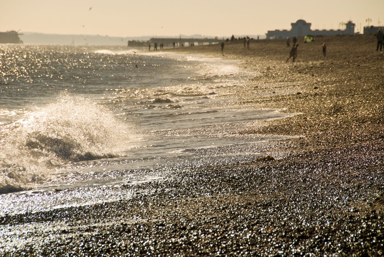 wave breaking on Eastney beach, Portsmouth, late afternoon in autumn