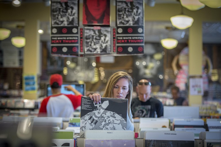 June 1, 2018 - Minneapolis, MN, USA - United States - Morgan Tilgner made her way through the vinyl records section at Electric Fetus, Friday, June 1, 2018 in Minneapolis, MN.   ]  ELIZABETH FLORES a?¢ liz.flores@startribune.com (Credit Image: © Elizabeth