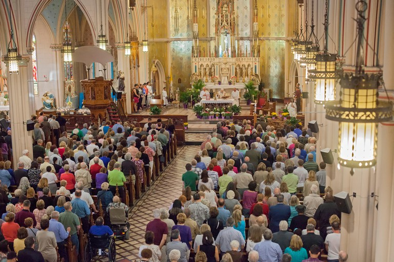 "Detroit, Michigan - A ""mass mob"" fills Ste. Anne de Detroit Catholic Church for Sunday morning mass."