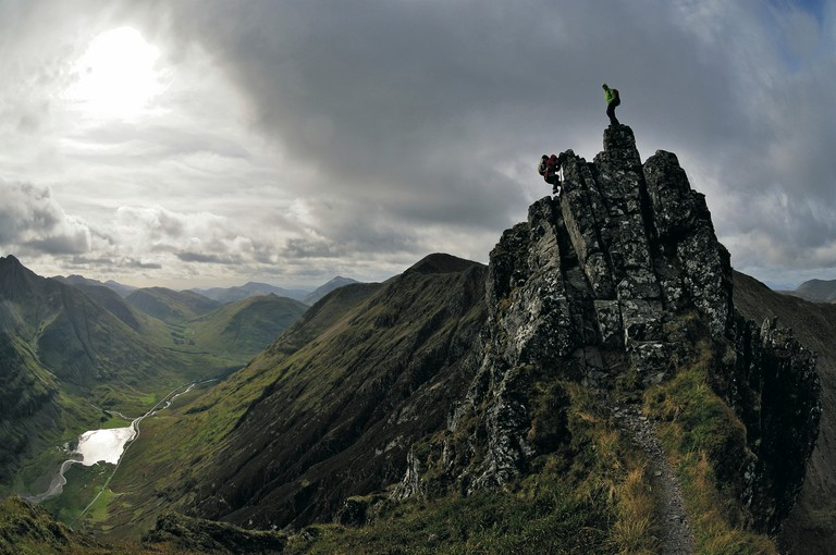 Hikers on the ridge of Aonach Eagach, Glen Coe, Highlands, Scotland, Great Britain