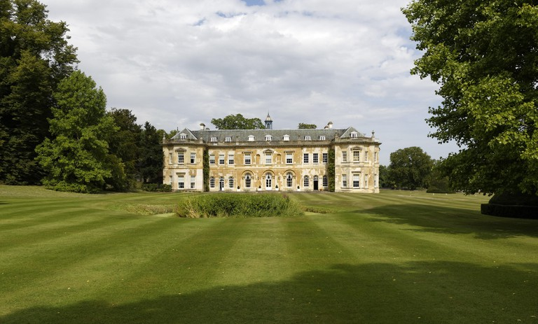 View across parkland to Hartwell House, Buckinghamshire. Hartwell House Hotel, Restaurant and Spa, is part of the Historic House Hotels group.