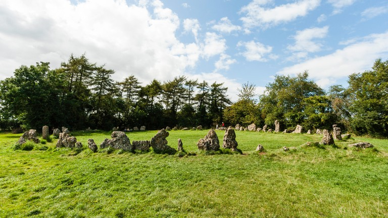 England, Oxfordshire, The Rollright stones. A late Neolithic, bronze age, ceremonial Stone Circle, called 'The King's Men'. Daytime, summer, blue sky.