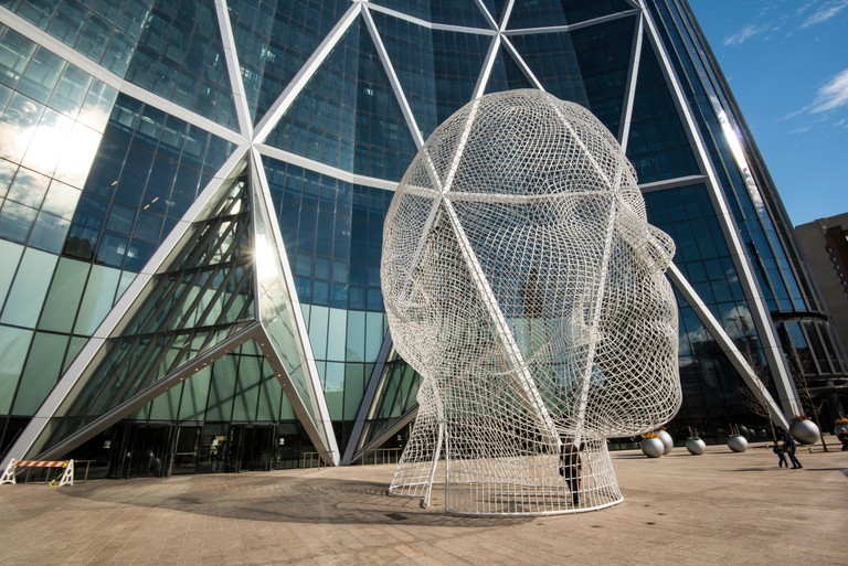 The Bow, office building in Calgary, Alberta, Canada. Design by Norman Foster, architect. 'Wonderland', sculpture by Jaume