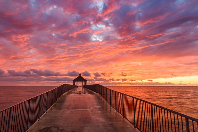 The fishing pier on Lake Pontchartrain at sunset, Fontainebleau State Park, Louisiana, USA.