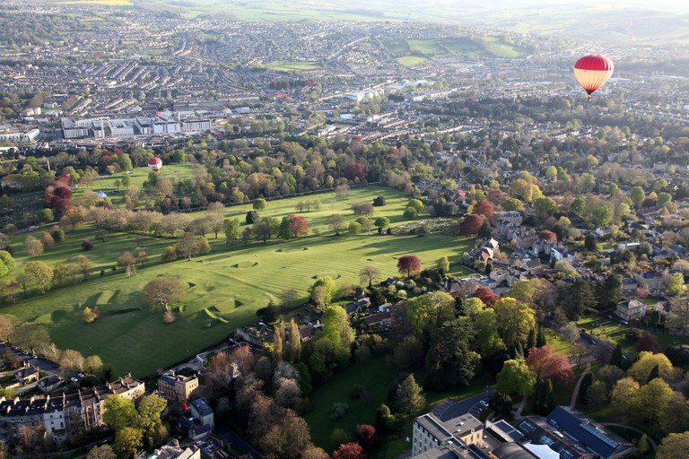 Hot air balloons leaving the ground in bath on an evening flight over the City of Bath