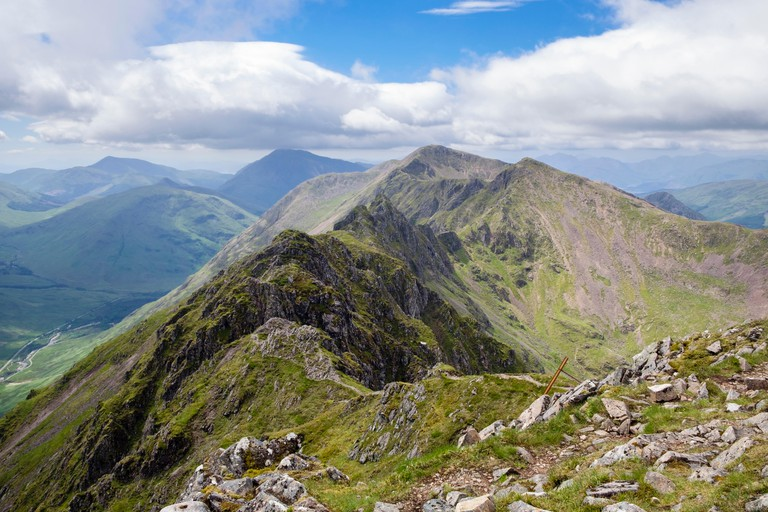 View west on Aonach Eagach mountain (Notched Ridge) seen from Meall Dearg above Pass of Glen Coe in Scottish Highlands. Glencoe Highland Scotland UK