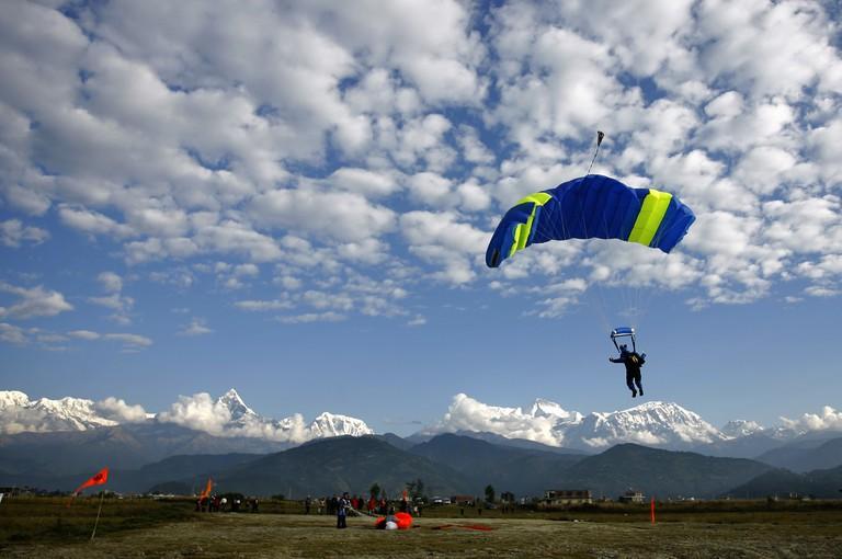 An Everest Skydive team member lands at