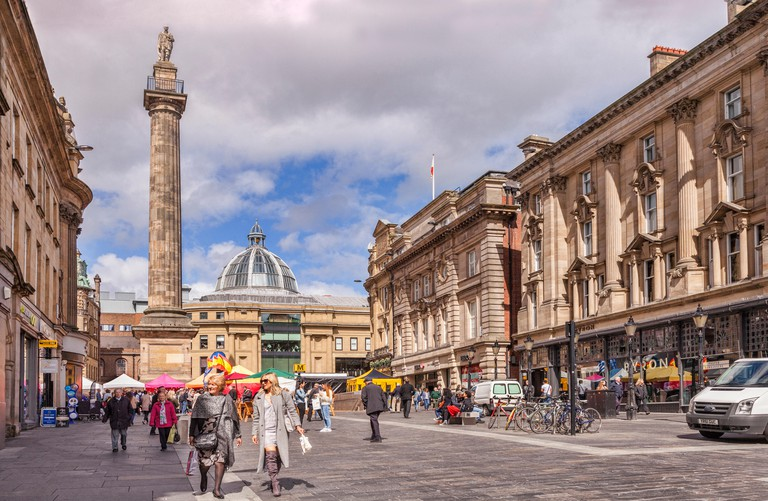 Greys Monument and shoppers in Grey Street, regularly voted one of the best streets in England architecturally, Newcastle-upon-T