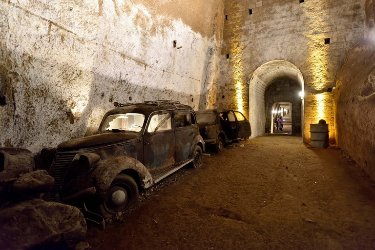 Old vintage cars in the Galleria Borbonica, Bourbon Tunnel, Naples, Campania, Italy