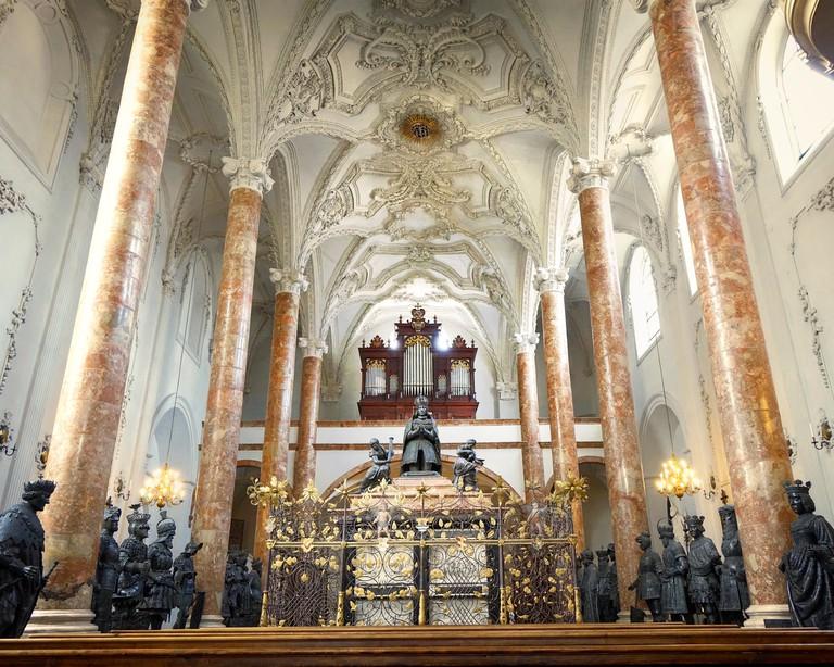 AT - TYROL: Emperor Maximilian's ornate black marble cenotaph inside the Hofkirche, Innsbruck