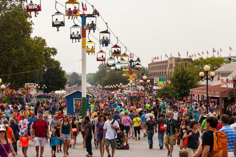 DES MOINES, IA /USA - AUGUST 10: Attendees at the Iowa State Fair. Thousands of people filling the midway at the Iowa State Fair on August 10, 2014 in