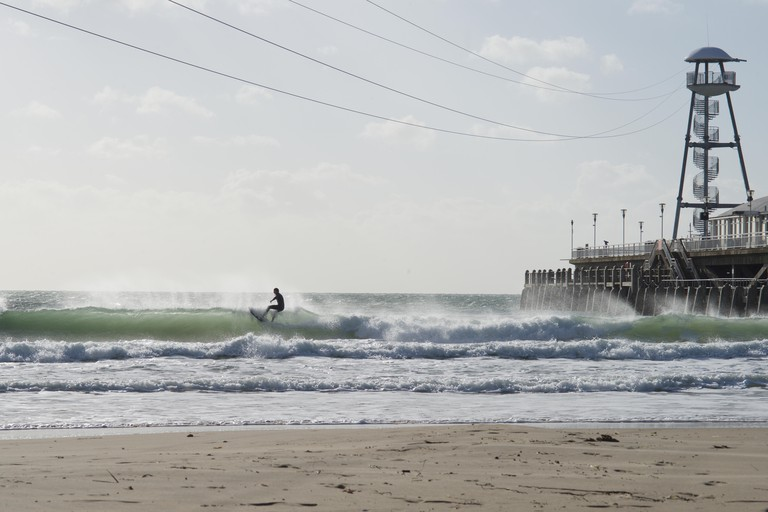 Surfer on the waves at Bournemouth