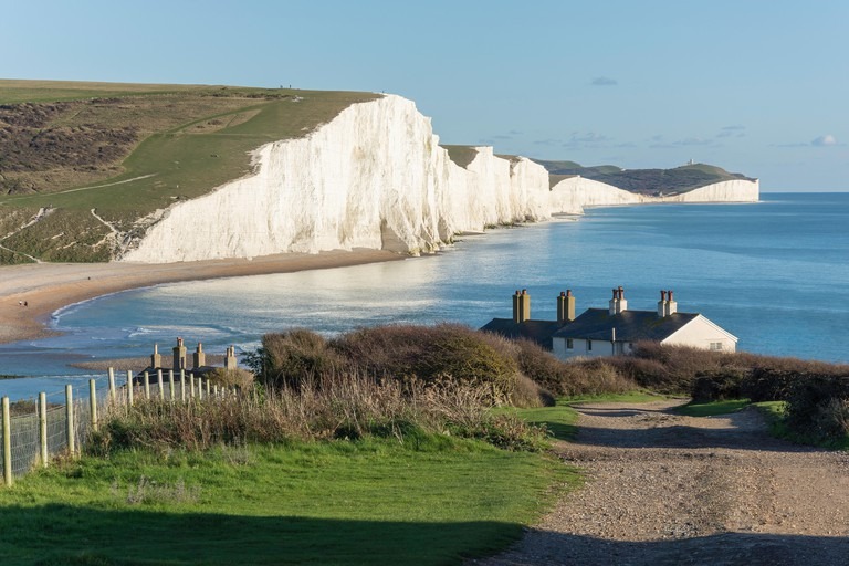 Seven Sisters Cliffs and Coastguard Cottages, Cuckmere Haven, Seaford Head Nature Reserve, Seaford, East Sussex, England, United Kingdom
