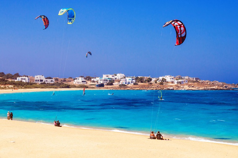 22.06.2016 - Paragliders and tourists at Mikri Vigla beach on Naxos island, Greece