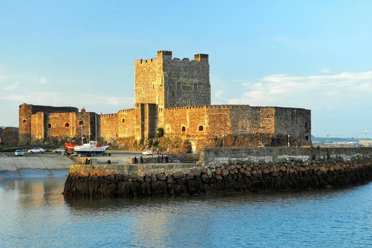 Carrickfergus Castle on the North Antrim Coast Road on shore of Belfast Lough. Norman period built by John de Courcy in 1177.